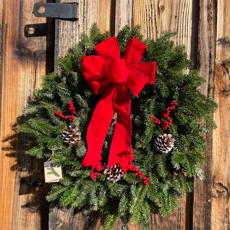 Wreath with red bow and pine cones