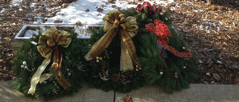Wreaths displayed on sidewalk