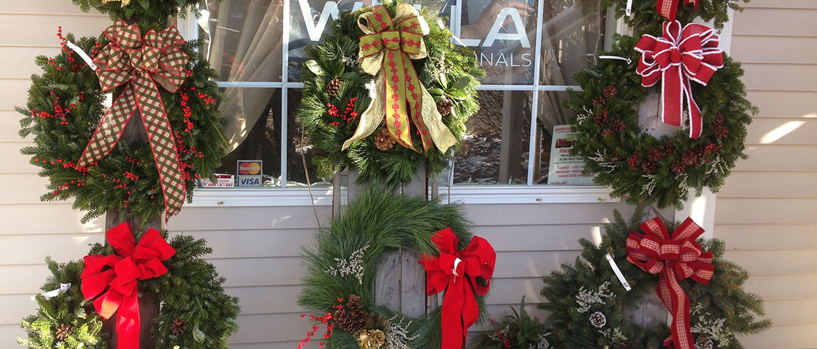 Wreaths displayed in store window